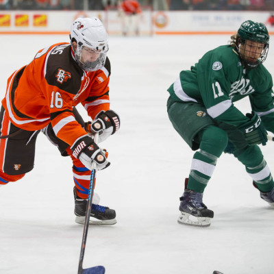 The Falcons' Brandon Hawkins (left) looks to make a play against Bemidji State last season. Hawkins' four power-play goals tied for the team lead last season (Photo by Todd Pavlack/BGSUHockey.com)