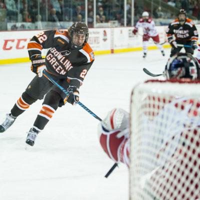 Bowling Green's Lukas Craggs moves in on Miami goalie Ryan Larkin earlier this season (Photo by Todd Pavlack/BGSUHockey.com).
