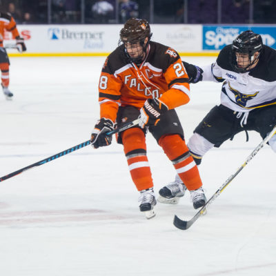 Bowling Green's Sean Walker (28) controls the puck against Minnesota State's Josh French during Saturday's game (Photo by Todd Pavlack/BGSUHockey.com).